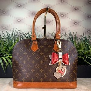 Authenticated Louis Vuitton Alma PM